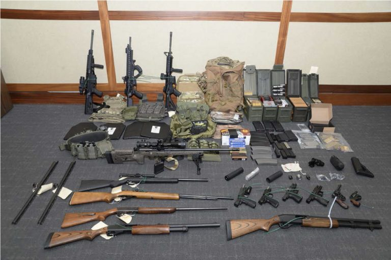 This image provided by the U.S. District Court in Maryland shows firearms and ammunition that figure in the case against Christopher Paul Hasson. Prosecutors say that Hasson, a Coast Guard lieutenant, is a