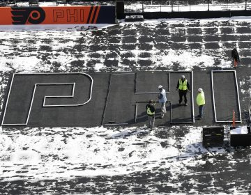 Workers continue preparations ahead of the NHL Winter Classic hockey game between the Pittsburgh Penguins and Philadelphia Flyers, in Philadelphia, Thursday, Feb. 21, 2019. (Matt Rourke/AP Photo)