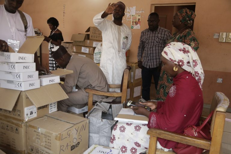 Electoral workers prepare identity card and biometric verification readers, at the offices of the local Independent National Electoral Commission office in Yola Nigeria, Friday, Feb. 22, 2019. (Sunday Alamba/AP Photo)