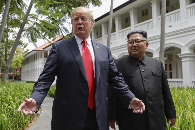 In this June 12, 2018, file photo, President Donald Trump and North Korea leader Kim Jong Un stop to talk with the media as they walk from their lunch at the Capella resort on Sentosa Island in Singapore. (Evan Vucci/AP Photo)