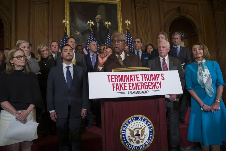 House Majority Whip James Clyburn of South Carolina speaks accompanied by Rep. Madeleine Dean, D-Pennsylvania, left, Rep. Joaquin Castro, D-Texas, House Majority Leader Steny Hoyer of Maryland, House Speaker Nancy Pelosi of California, right, and others about the resolution to block President Donald Trump's emergency border security declaration on Capitol Hill Monday.  (AP Photo/Alex Brandon)