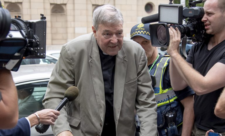 Cardinal George Pell arrives at the County Court in Melbourne, Australia, Tuesday. The most senior Catholic cleric ever charged with child sex abuse has been convicted of molesting two choirboys moments after celebrating Mass, dealing a new blow to the Catholic hierarchy's credibility after a year of global revelations of abuse and cover-up. (AP Photo/Andy Brownbill)