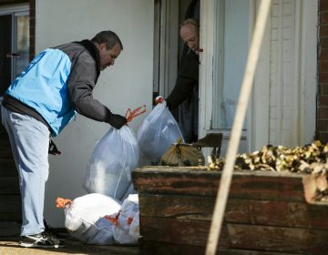 Investigators remove bags from a crime scene at the Robert Morris Apartments in Morrisville, Pa., Tuesday, Feb. 26, 2019. A Pennsylvania woman charged along with her teenage daughter in the deaths of multiple relatives, including children, was arraigned Tuesday on murder charges. The bodies were found Monday inside an apartment at the complex. (Matt Rourke/AP Photo)