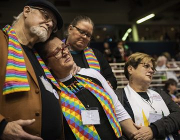 Ed Rowe, (left), Rebecca Wilson, Robin Hager and Jill Zundel, react to the defeat of a proposal that would allow LGBT clergy and same-sex marriage within the United Methodist Church at the denomination's 2019 Special Session of the General Conference in St. Louis, Mo., Tuesday, Feb. 26, 2019. (Sid Hastings/AP Photo)