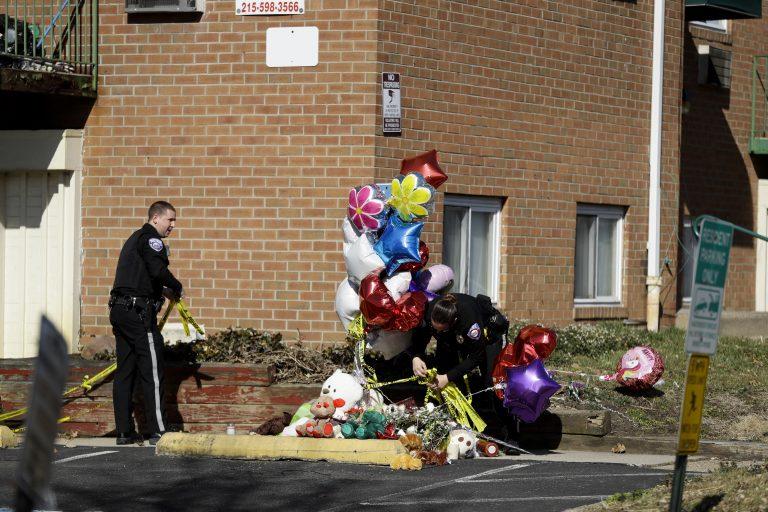 Police officers remove crime scene tape near a makeshift memorial outside the Robert Morris Apartments, Thursday, Feb. 28, 2019, in Morrisville, Pa. (Matt Slocum/AP Photo)