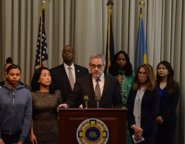Philadelphia District Attorney Larry Krasner and supporters make an announcement on handling of juvenile criminal justice cases. (Tom MacDonald/WHYY)