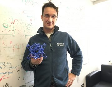 Chris Wilmer, assistant professor of chemical engineering at the University of Pittsburgh, holds a model of a metal organic framework. (Amy Sisk/StateImpact Pennsylvania)