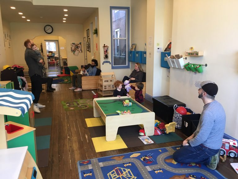 Children and parents hang out at the LilyPad volunteer-run play place. (Jad Sleiman/WHYY)