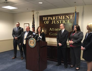 Kathy Jennings, Delaware's new attorney general, was flanked by some of her top deputies Monday as she announced policy changes she contends would make the state's justice system fairer for everybody, including defendants, without jeopardizing public safety. (Cris Barrish/WHYY)