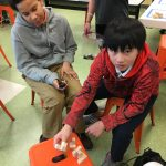 Chauncey and Noah show pieces of the 3D puzzle they designed in class at The College School in Newark, Delaware. (Mark Eichmann/WHYY)