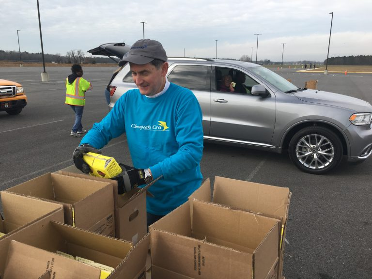 Volunteers load food into cars at the Food Bank of Delaware's mobile food pantry in Georgetown, Delaware on Friday. (Mark Eichmann/WHYY)