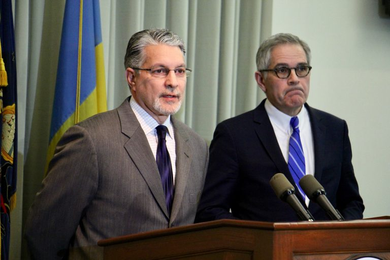 Anthony Voci (left) with District Attorney Larry Krasner