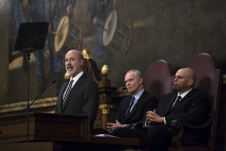 Democratic Gov. Tom Wolf, left, delivers his budget address for the 2019-20 fiscal year to a joint session of the Pennsylvania House and Senate in Harrisburg, Pa., Tuesday, Feb. 5, 2019. House Speaker Mike Turzai, R-Allegheny, is at the center, and Lt. Gov. John Fetterman is at the right.