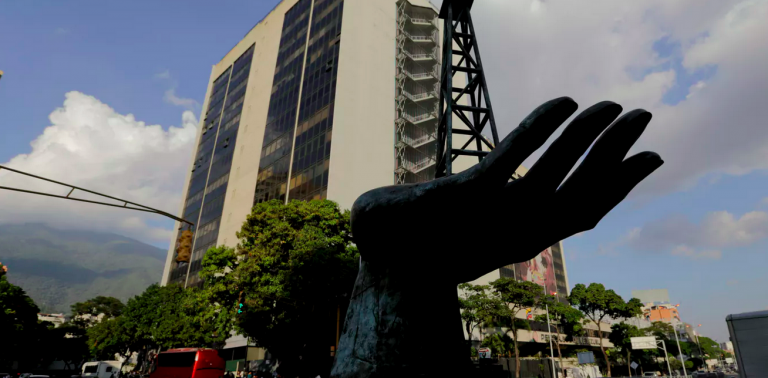 A sculpture of an oil pump held by a human hand stands outside the headquarters of Venezuela's state-owned oil company. (Fernando Llano/AP Photo)