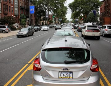Cars parked in the median on South Broad Street. (Emma Lee/WHYY)