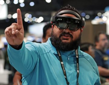 Raman Ghuman demonstrates a HoloLens device at Microsoft's annual conference for software developers on May 7, 2018, in Seattle. Microsoft workers are protesting the use of the augmented reality technology in a U.S. Amy contract. (Elaine Thompson/AP)