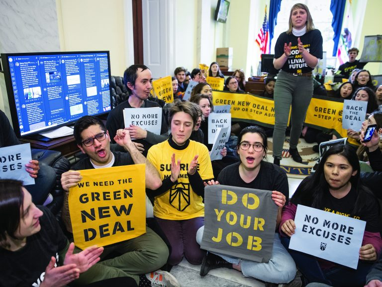 Environmental activists occupy the office of House Democratic Leader Nancy Pelosi this past December. They plan more sit-ins to push for support of a sweeping resolution to address climate change. (J. Scott Applewhite/AP Photo)