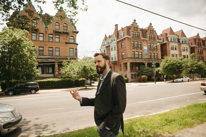 Chris Spahr, director of Centennial Parkside CDC, on Parkside Avenue. (Neal Santos for PlanPhilly)