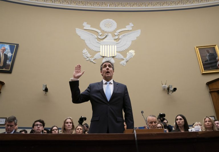 Michael Cohen, President Donald Trump's former personal lawyer, is sworn in to testify before the House Oversight and Reform Committee on Capitol Hill in Washington, Wednesday, Feb. 27, 2019. (J. Scott Applewhite/AP Photo)