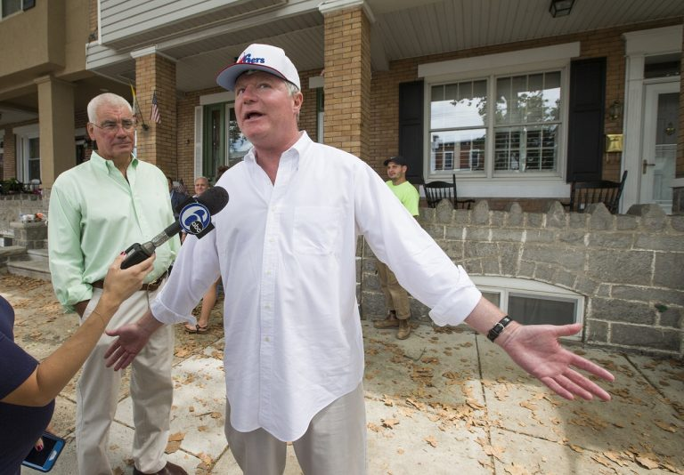 John Dougherty, (right), makes some brief comments to the media, in Philadelphia. The powerful union boss who has held a tight grip on construction jobs and politics in the Philadelphia region and beyond has been indicted in an FBI probe along with a city councilman and at least six others. Federal prosecutors say Dougherty used union funds as