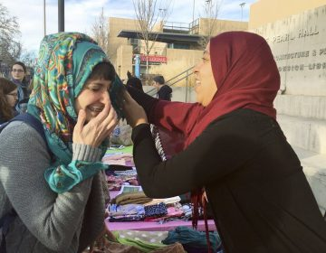 A student on the campus of the University of New Mexico in Albuquerque, trying out the hijab on World Hijab Day, 2017. (Russell Contreras/AP Photo)