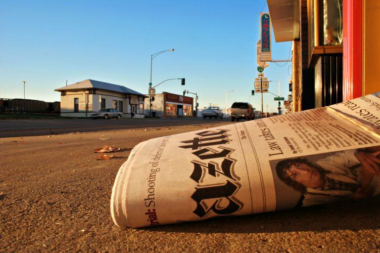 Local newspapers keep readers' interest on local politics. (Shutterstock/Bridget McPherson)
