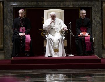Pope Francis sits during the traditional greetings to the Roman Curia at the Vatican in December 2018. (Filippo Monteforte/Pool Photo via AP)