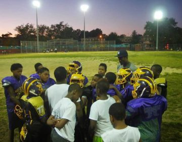 Mo Better Jaguars' coaches and players huddle at the end of practice at Betsy Head Park in Brownsville, Brooklyn in September 2014. (Courtesy of Albert Samaha)