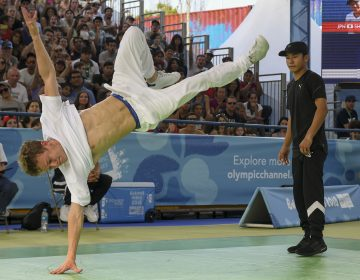 Paris Olympics organizers want breakdancing to be part of the 2024 Olympics. The sport was part of the Youth Olympic Games in Buenos Aires last fall, when Russian b-boy Bumblebee (left) defeated Japan's b-boy Shigekix in the gold-medal battle. (Eitan Abramovich /AFP/Getty Images)