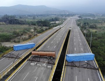 The Tienditas Bridge connecting Colombia and Venezuela has been blocked by Venezuelan military forces, as seen here on Wednesday. Opposition leader Juan Guaidó and U.S. Secretary of State Mike Pompeo are demanding that humanitarian aid be allowed to enter. (Edinson Estupinan/AFP/Getty Images)