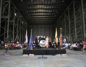 State and local government officials attend a ceremony for the raising of the final steel beam at Holtec International. on July 8, 2016. The company got $260 million in tax incentives to build its manufacturing plant in Camden.
