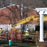 Crews worked on Monday Jan. 21 to stabilize a new sinkhole that opened up at Lisa Drive, a suburban development in West Whiteland Township, Chester County where Sunoco operates its Mariner East pipelines. (Jon Hurdle/StateImpact Pennsylvania)