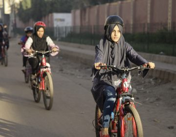 Zulekha Dawood leads the group of female cyclists through the impoverished Lyari neighborhood in Karachi, Pakistan's capital. They ride early in the morning to avoid the worst of the traffic. (Diaa Hadid/NPR)