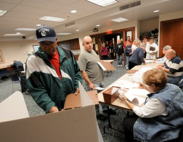Commissioners in Sandusky, Ohio, have voted to make Election Day a city holiday, in place of Columbus Day. Sandusky resident Moses Croom is seen here voting at a polling station at a local library in November 2008. (Jason Werling/Sandusky Register)