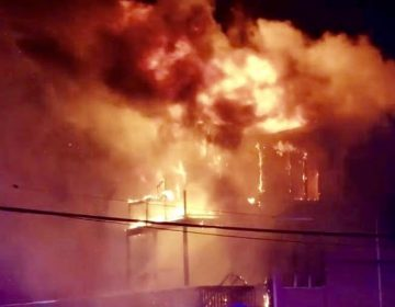 Flames engulf a townhouse on Ocean Avenue in Sea Bright Friday night. (Image: Unexcelled Fire Company - Neptune)