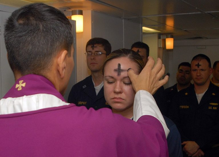 US Navy employees receive the sacramental ashes during an Ash Wednesday celebration (U.S. Navy photo by Mass Communication Specialist 3rd Class Brian May/Public domain)