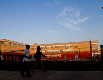 Students head to school at the now-shuttered Germantown High School. (Brad Larrison for WHYY)