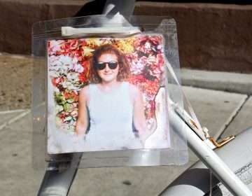A ghost bike memorial to Laura Fredericks still stands at the intersection of 11th and Spruce streets, where she was struck and killed by a garbage truck while riding in the bike lane. (Emma Lee/WHYY)