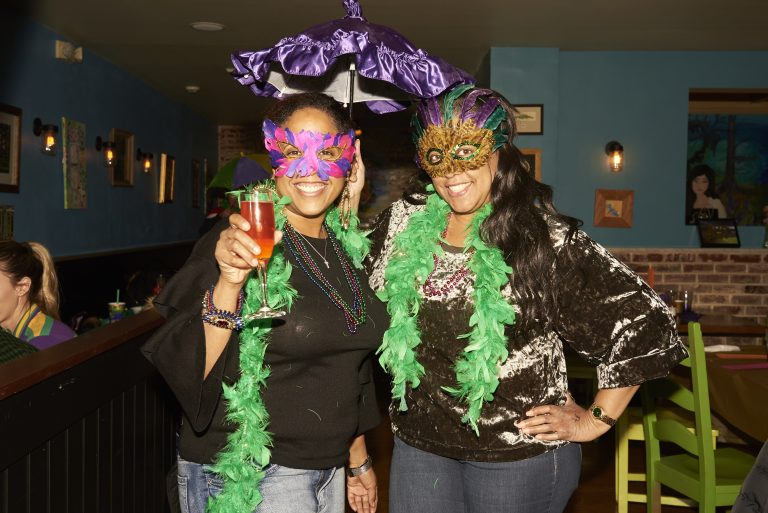 Marki and Deenee Levere celebrate Fat Tuesday at Acadia Bar in South Philadelphia. (Natalie Piserchio for WHYY)