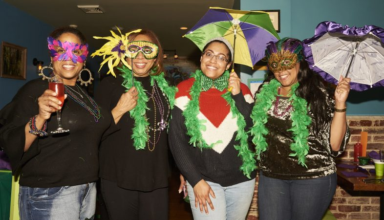 Marki Levere, Tarlynn Levere, Anessa Cross, and Deenee Levere celebrate Fat Tuesday at the Acadia Bar in South Philadelphia. (Natalie Piserchio for WHYY)