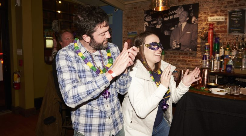 Mike and Heidi Bondiskey dance at the Acadia Bar in South Philadelphia to celebrate Mardi Gras. Together, they've visited New Orleans six times. (Natalie Piserchio for WHYY)