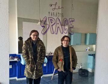 Members of the artists' collective Space 1026 Maximillian Lawrence (left) and John Armstrong, stand in the new space they purchased on North Broad Street, a former hairdresser's shop. (Peter Crimmins/WHYY)