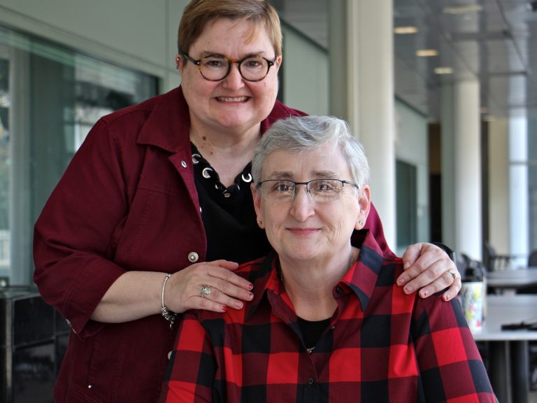 The Rev. Dr. Karyn Wiseman, a former United Methodist pastor (right), and her wife, Cindy Clawson. (Emma Lee/WHYY)