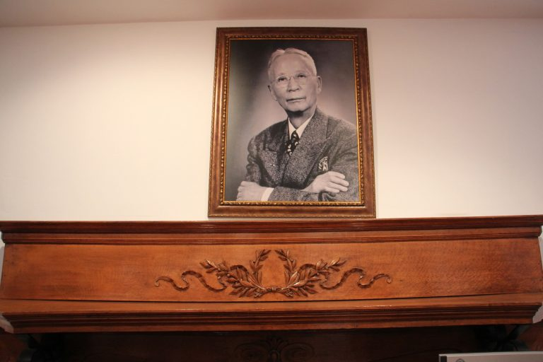 A portrait of Dr. Philip Jaisohn, the first Korean-American to receive a U.S. medical degree, hangs above the mantle at his home in Media, Pa.  The home is now a museum chronicling Jaisohn's life and his involvement in the Korean indepencence movement. (Emma Lee/WHYY)