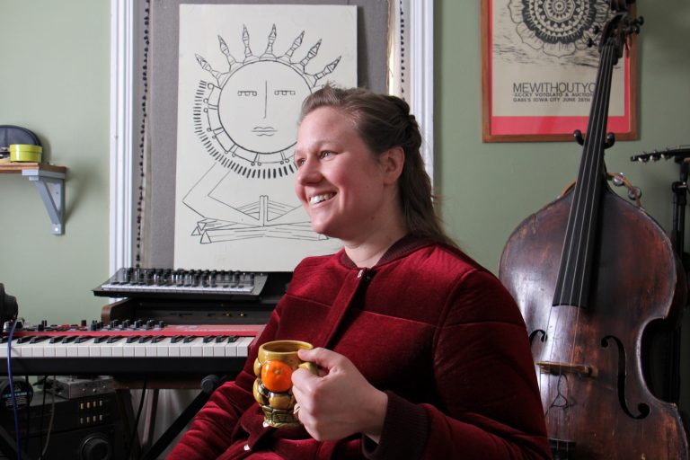 Philadelphia singer-songwriter Birdie Busch at her home studio in Germantown. Busch wrote eight original songs inspired by the art of women in the collection of the Philadelphia Museum of Art, and will perform them Friday night at the museum. (Emma Lee/WHYY)