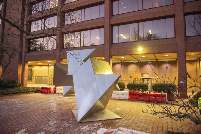 White Water, a sculpture by Philadelphia artist Robinson Fredenthal is moved from the garden behind the Wells Fargo building in Old City to its new home at the Woodmere Art Museum in Chestnut Hill. (Jonathan Wilson for WHYY)