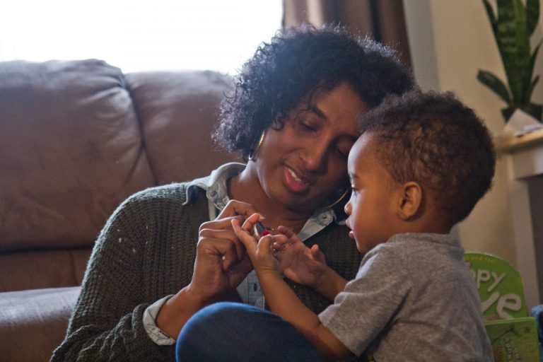 Stephanie Lee remembers the period after her son Santeno, 2, was born. (Kimberly Paynter/WHYY)