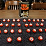 The method of determining ballot position in Philadelphia involves 34 numbered balls and a Horn & Hardart coffee can. (Emma Lee/WHYY)
