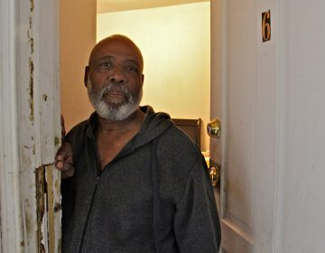 James Smith Jr. rents a room in Victor Pickney's rooming house. (Emma Lee/WHYY)