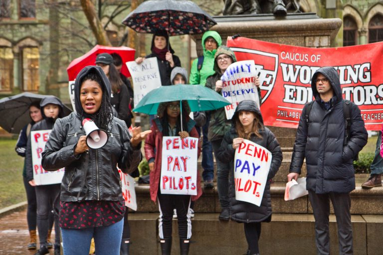 Gina Dukes, a Penn alumna and a Philadelphia school district teacher, speaks at a rally to demand UPenn make PILOT payments. (Kimberly Paynter/WHYY)